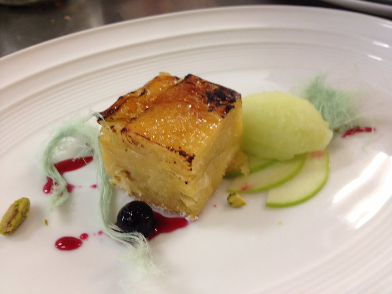 VANILLA AND APPLE PAIN PERDU, APPLE SORBET AND BLUEBERRY COMPOTE