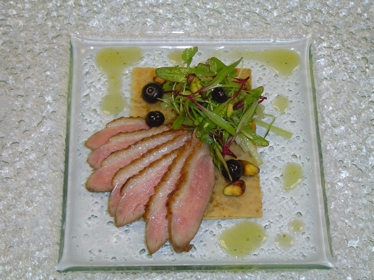 TEA SMOKED DUCK RESTING ON CRISP FILO PASTRY, PISTACHIO, CELERY & GRAPE SALAD WITH BLUEBERRY & RIESLING VERJUS DRESSING
