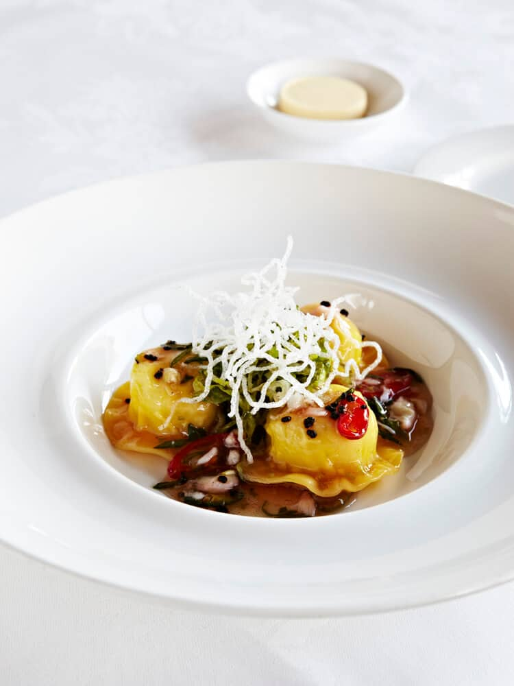 STEAMED SPANNER CRAB WONTON RAVIOLO, SHREDDED ROOT VEGETABLE SALAD, CORIANDER AND SHISO DRESSING
