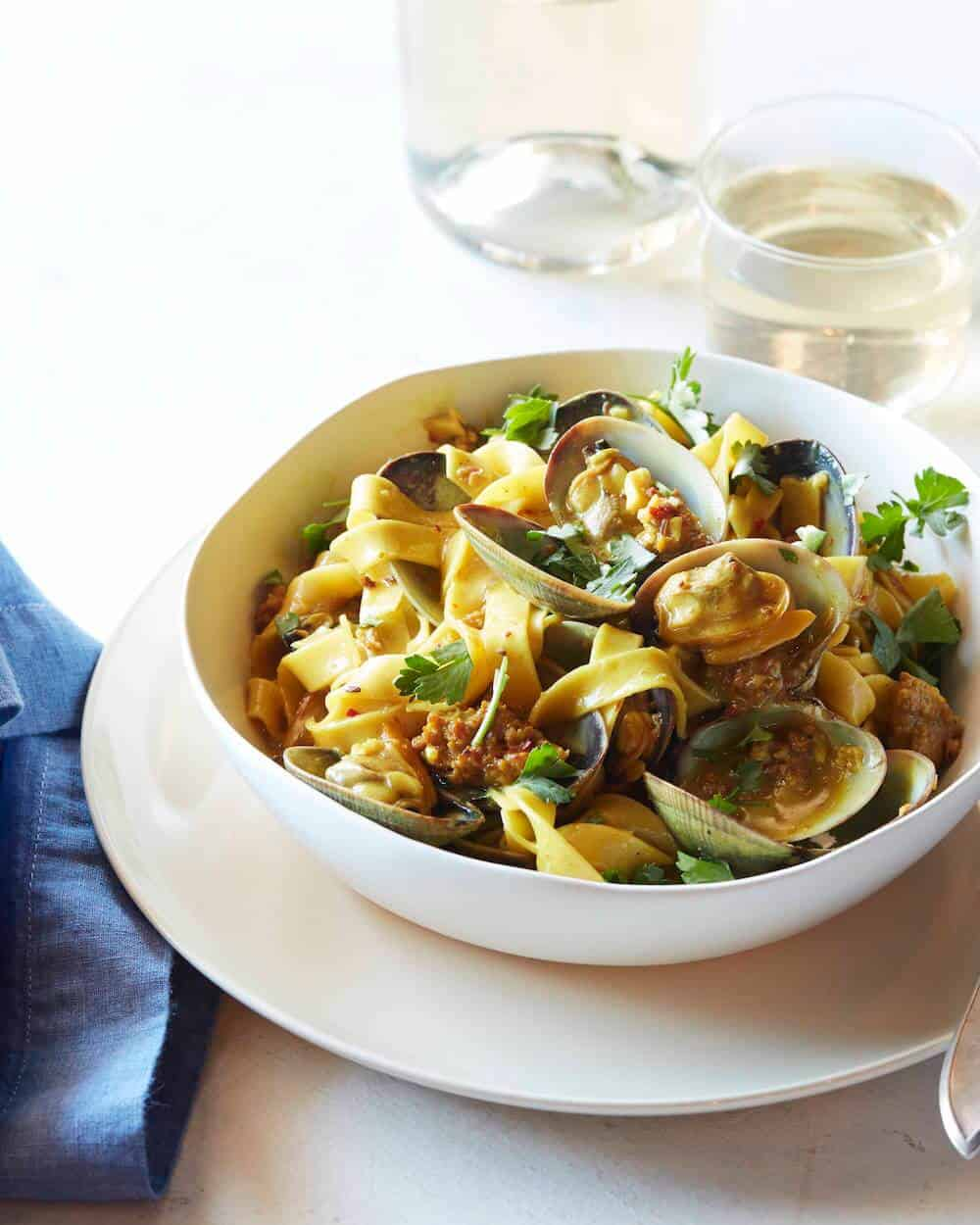 Fresh Egg Fettuccine with Manila Clams, Spicy Sausage and White Wine Saffron Reduction