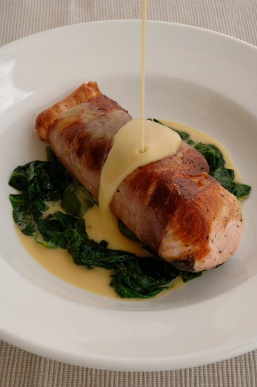 PROSCIUTTO WRAPPED SALMON FILLET WITH WILTED SPINACH AND LEMON BEURRE BLANC