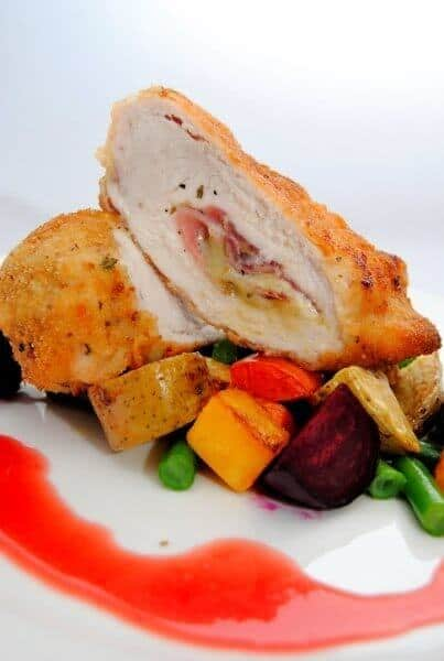 CHICKEN CORDON BLEU ON ROASTED VEGETABLES WITH A BEETROOT AND CHICKEN JUS