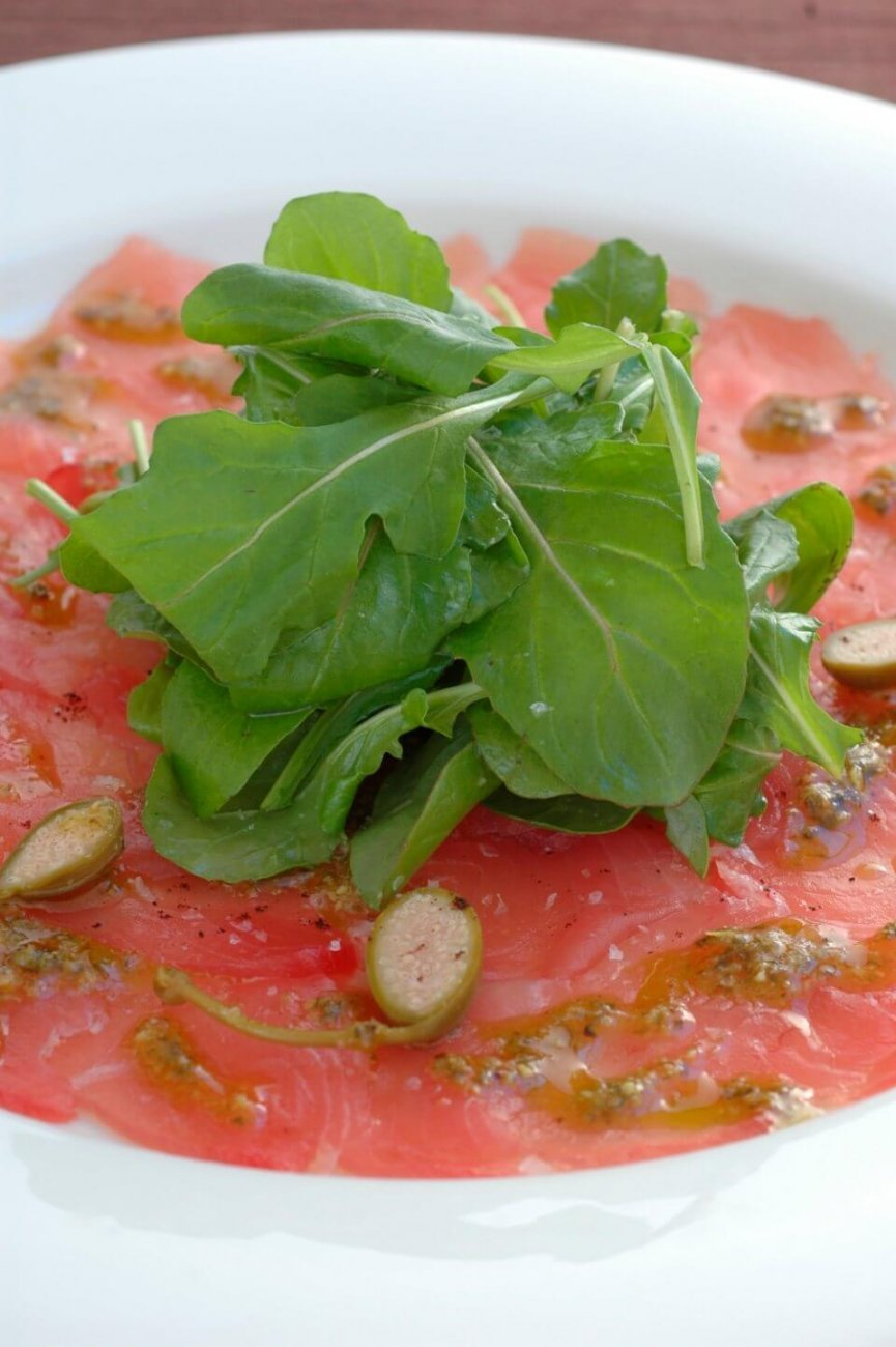 TUNA CARPACCIO WITH BASIL OIL, LEMON AND CAPER BERRIES