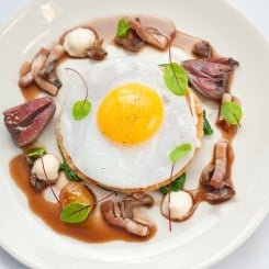 DUCK EGG TART WITH RED WINE SAUCE, TURNIP PUREE, LARDONS, YOUNG SORREL AND SAUTÉED DUCK HEART