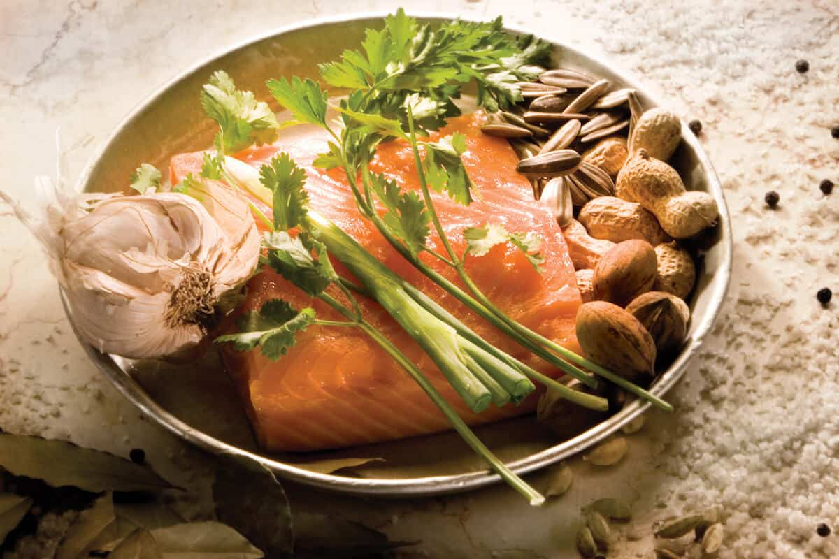 SALMON CONFIT WITH HERBS AND NUTS
