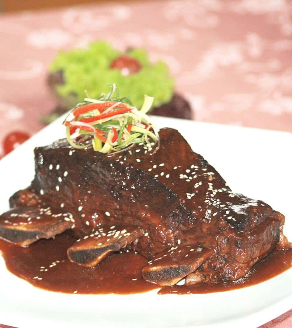Braised Beef Short Ribs in Spiced Orange Tamarind Sauce