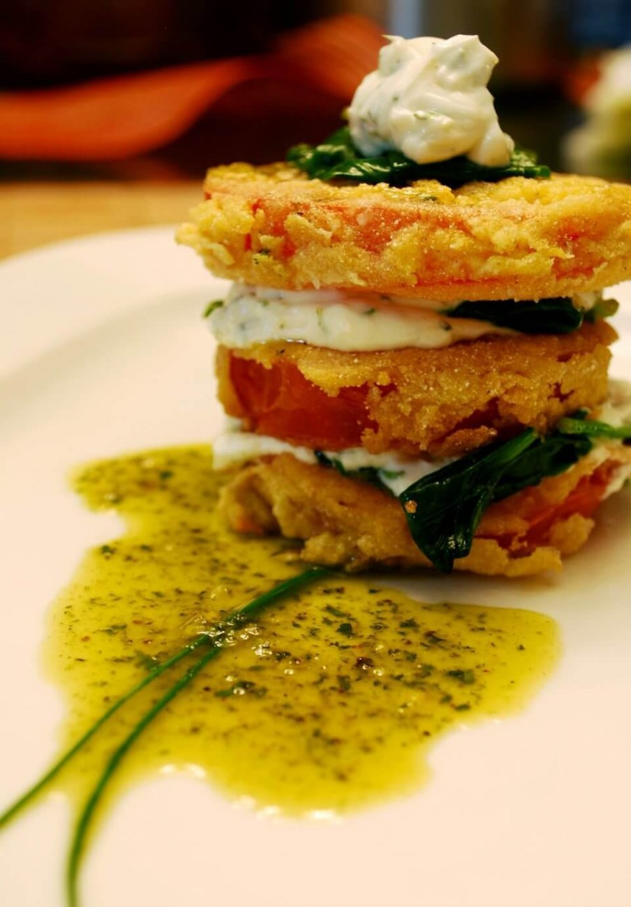 CORN-FRIED TOMATO, HERBED CREAM CHEESE, SPINACH, LEMON-BASIL OIL