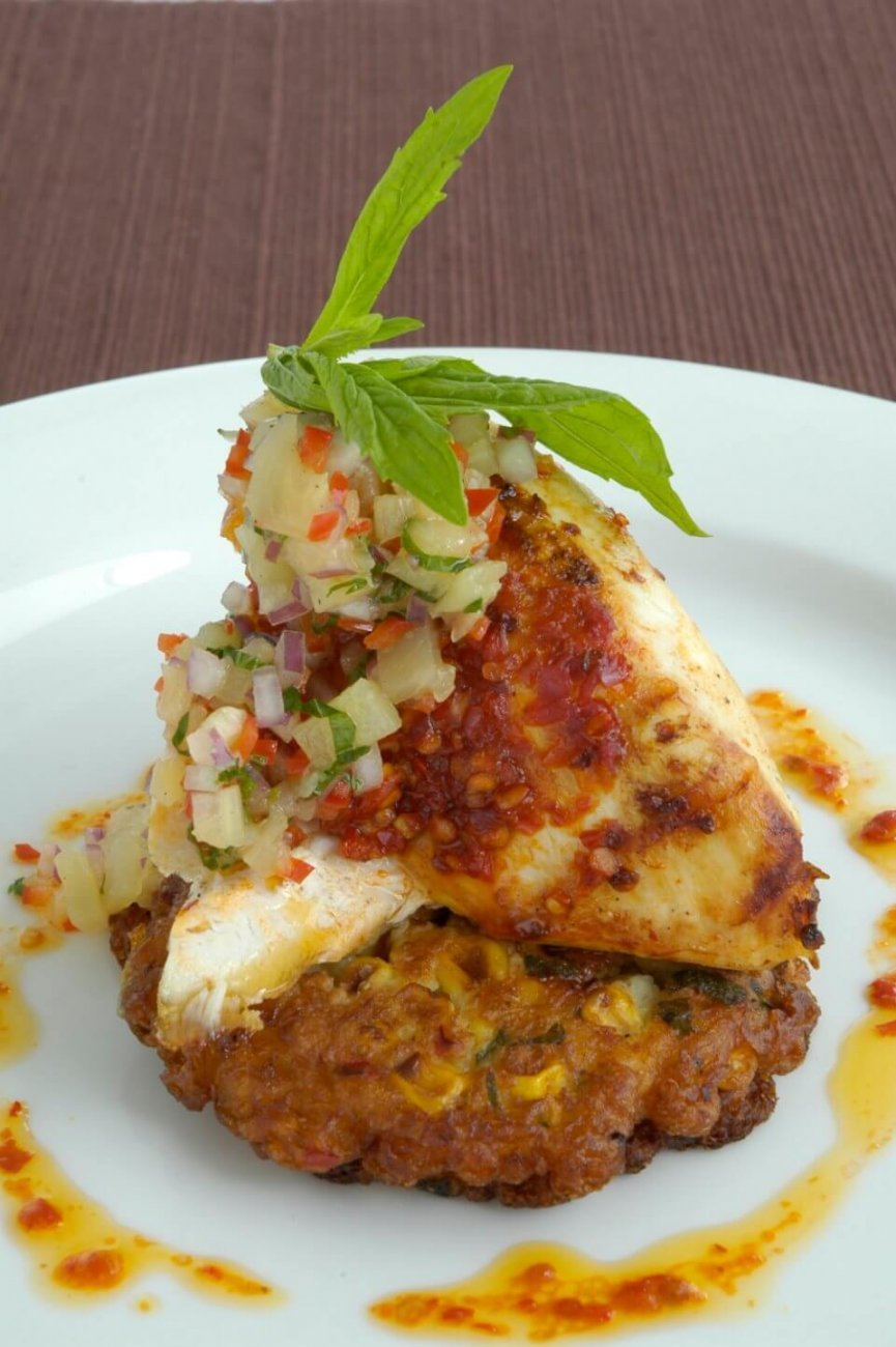 HARISSA MARINATED CHICKEN ON CORN AND CORIANDER FRITTERS WITH PINEAPPLE SALSA