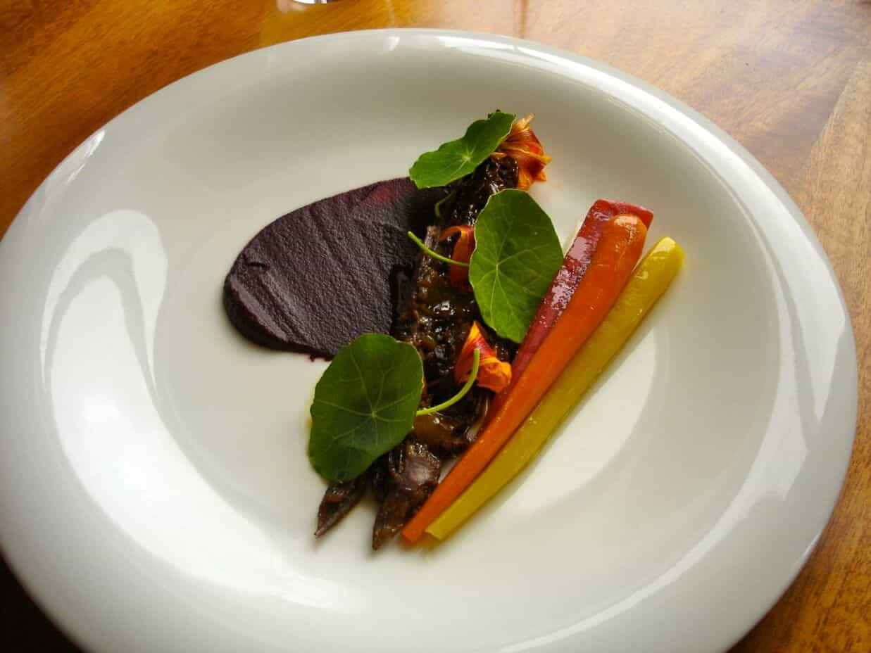 WAGYU OXTAIL, HEIRLOOM CARROTS, PICKLES, NASTURTIUM