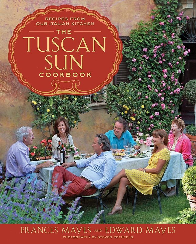 cover book with a family having lunch outside an old beautiful house