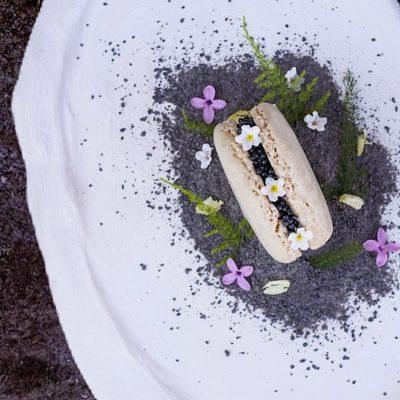 "Cashew macaron, Caviar, Homemade Labnah Cheese, Volcanic sepia ""ash""."