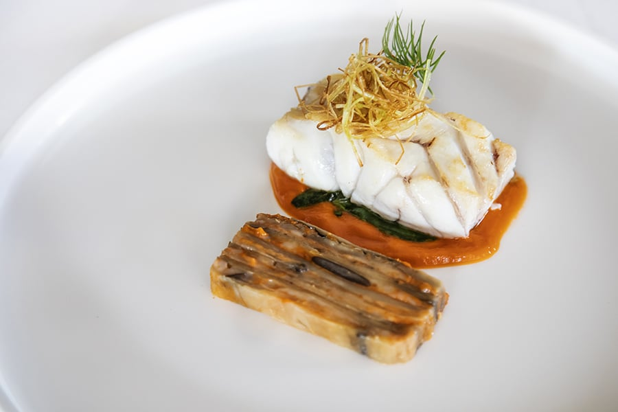 close-up of a plate with Grouper, eggplant and Tomato Fondue