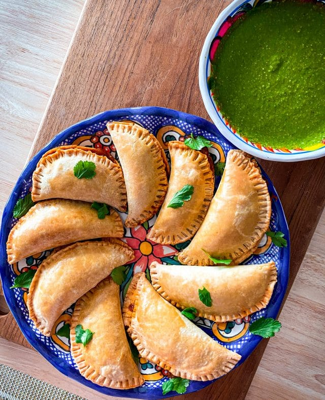 Oxtail Empanadas with side chimichurri sauce