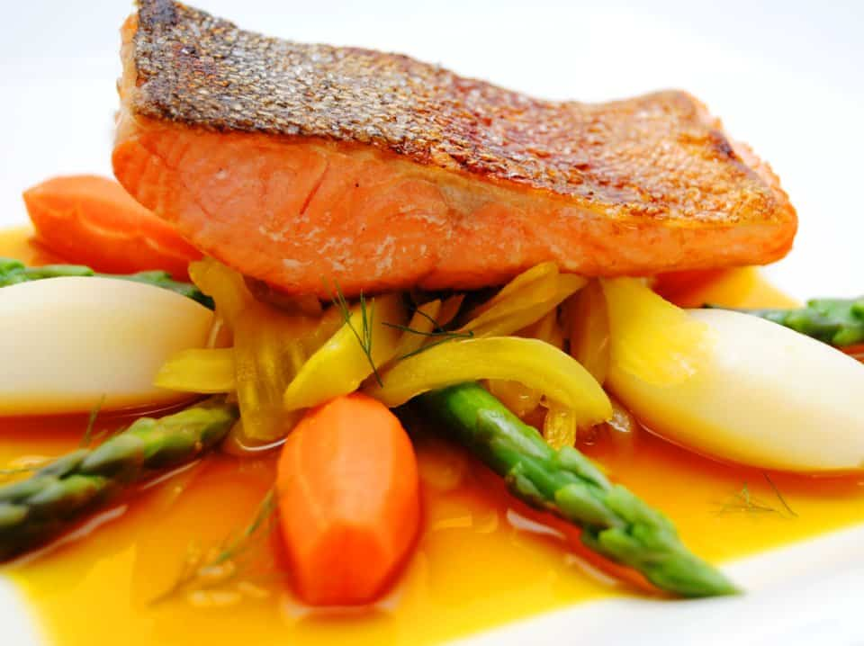 Crispy skin ocean trout on saffron braised fennel and grilled asparagus