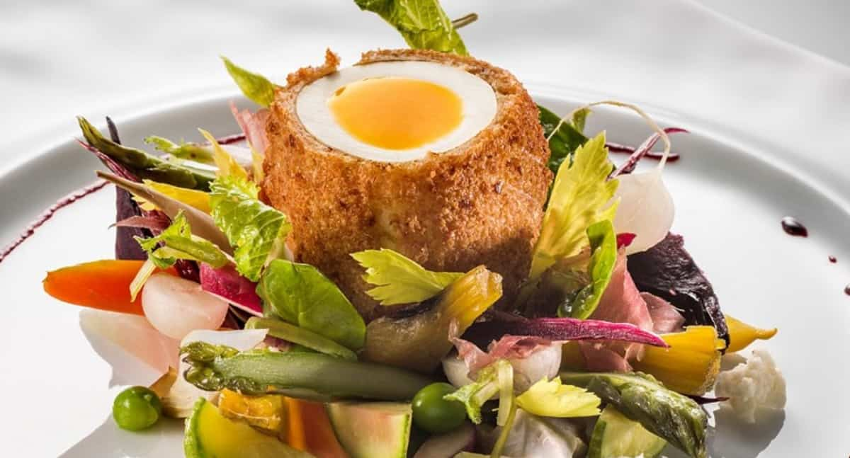SOFT-BOILED EGG COATED IN BRIOCHE WITH WINTER VEGETABLES AND VIANDE DES GRISONS SHAVINGS
