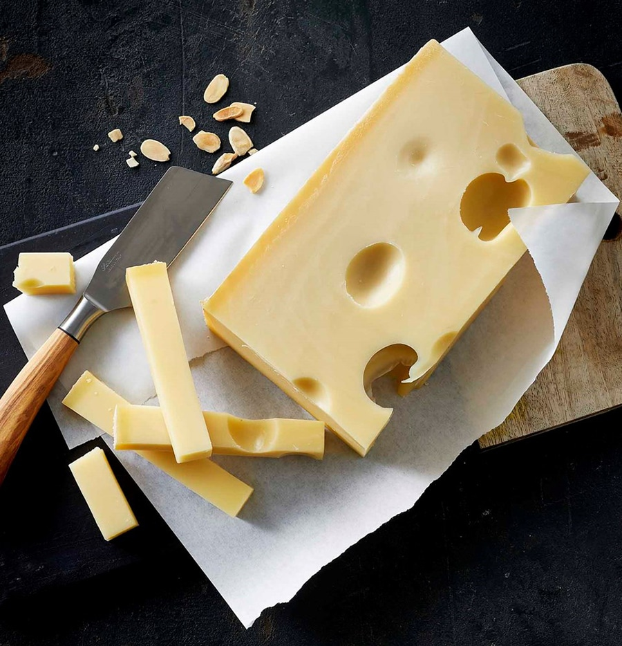 emmenthal cheese with a knife