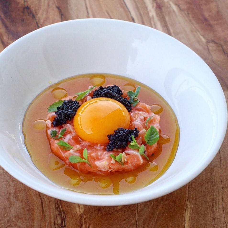 Salmon tartare,sweet onion water,smoked olive oil,organic egg yolk,caviar