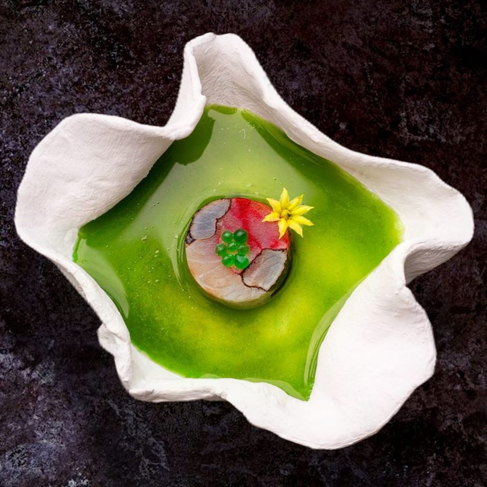 Sea bass mosaic, fermented tomato water, smoked olive oil & sea weed gelification, cucumber caviar