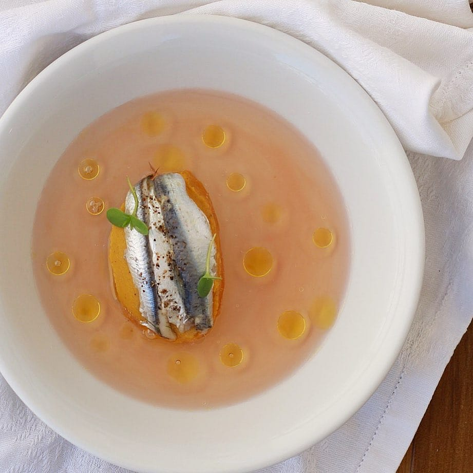 Yellow fava beans from Schoinoussa with my homemade marinated sardines,a clear broth from sweet Cretan tomatoes infused with mint and sweet rose wine and drops of smoked olive oil