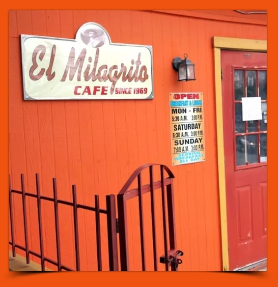 a bright orange entry of a small cute coffee place